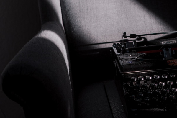 Typewriter on wing chair