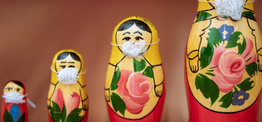 Four dolls in masks